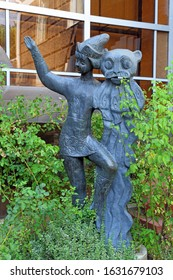 Krasnodar, Russia-AUGUST 16, 2015: sculptures of fairy-tale characters Cat and Petrushka at the entrance of the Regional puppet theater. 31 Krasnaya Street