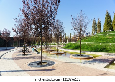 Krasnodar, Russia-October 19, 2018: places of rest in the water zone of the new modern city Park, built at the expense of Russian businessman Sergei Galitsky. Sunny autumn day