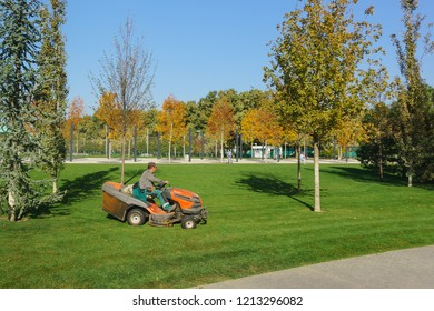 Krasnodar, Russia-October 19, 2018: a worker at the Husqvarna minitractor collects fallen leaves on the lawns in the new city Park Krasnodar near the stadium of the football club of the same name
