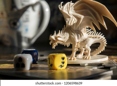 Krasnodar/Russia  – October 17, 2018: Playing Descent board game, role playing game, dungeons and dragons, dnd. Figure of dragon, dices. Board games. Blurred background.