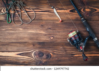Krasnodar/Russia-11.17.2018: Fishing tackle on darken wooden background.Top view.