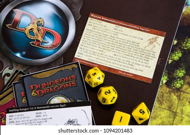KRASNODAR/RUSSIAN FEDERATION – 19 May 2018: Playing Dungeons and Dragons, a role playing game, dnd. A book about dnd with dices on it. Board games.