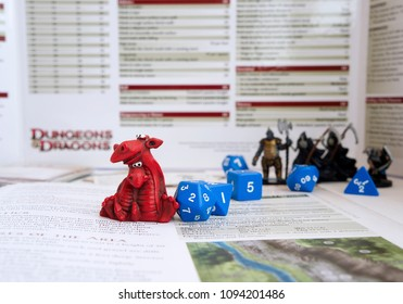 KRASNODAR/RUSSIAN FEDERATION – 19 May 2018: Playing Dungeons and Dragons, a role playing game, dnd. Miniature of two dragons, D&D figures and dices on background. Board games.