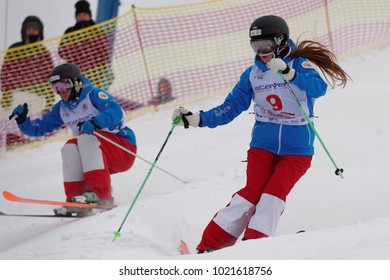 KRASNOE OZERO, LENINGRAD REGION, RUSSIA - FEBRUARY 1, 2018: Yelizaveta Bezgodova (in front) and Ksenia Kuznetsova, both of Russia, compete in dual mogul during Freestyle Europa Cup competitions