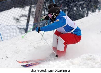 KRASNOE OZERO, LENINGRAD REGION, RUSSIA - FEBRUARY 1, 2018: Ksenia Kuznetsova (blue) and Anastasiya Pervushina, both of Russia, compete in dual mogul during Freestyle Europa Cup competitions