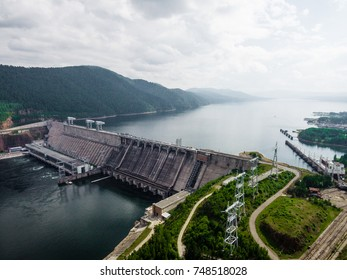 Krasnoyarsk Dam on Yenisei River from aerial view. Hydropower plant generating electricity