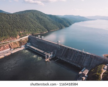 Krasnoyarsk hydroelectric station dam, hydro power plant on Enisey river from aerial view. Krasnoyarsk reservoir. Industrial landscape