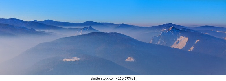 "Krasnoyarsk region, Krasnoyarsk, reserve ""Stolby"" winter mountain landscape in the fog, panorama"