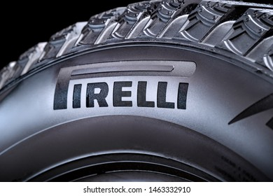Krasnoyarsk, Russia, 28 july 2019: Pirelli logo on the side of the tire, close-up, black background.