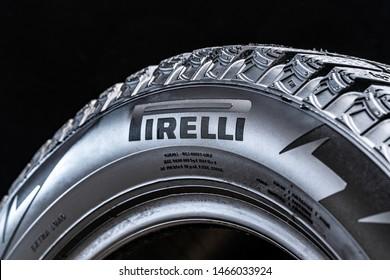 Krasnoyarsk, Russia, 28 july 2019: Pirelli logo on the side of the tire, close-up, black background