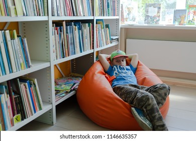 Krasnoyarsk, Russia- circa july 2018:  Lazy young boy lies on the chair in school