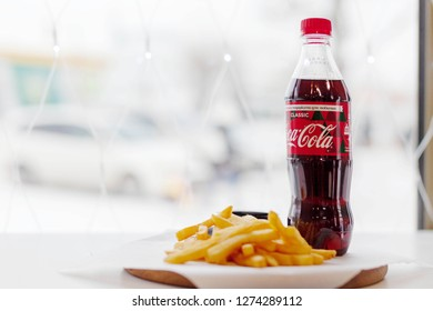 Krasnoyarsk, Russia, December 2018: french fries and coca cola in a fast food cafe, editorial