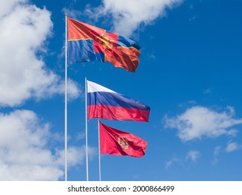 Krasnoyarsk. Russia - July 15, 2020: Flags of the city of Krasnoyarsk, Krasnoyarsk Territory and Russia are developing against the background of the sky