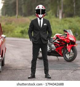 KRASNOYARSK, RUSSIA - July 27, 2020: A motorcyclist in a business black suit and helmet.