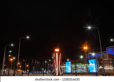 Krasnoyarsk, Russia, March 2019:  object of the 2019 Winter Universiade Platinum Arena Krasnoyarsk, torch of the 2019 Winter Universiade, night view