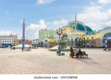 Krasnoyarsk, Russia - March 27, 2021: City square in front of the Krasnoyarsk-Passazhirsky station. Main railway station of Krasnoyarsk located at 4098 km of the Trans-Siberian Railway.