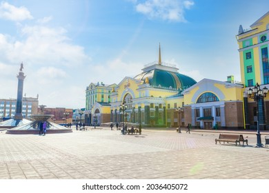 Krasnoyarsk, Russia - March 27, 2021: Krasnoyarsk-Passazhirsky is the main railway station of Krasnoyarsk. Located at 4098 km of the Trans-Siberian Railway. City square in front of the station