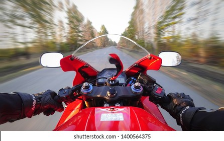 KRASNOYARSK, RUSSIA - May 15, 2019: First person view on a red sports motorcycle. Sportbike in the first person. Honda CBR 600 RR.