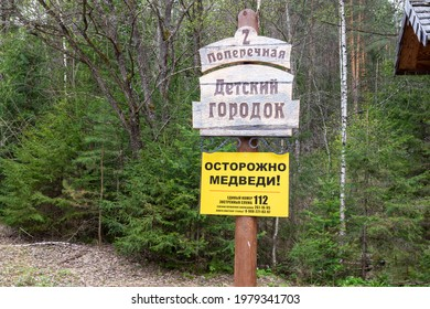 Krasnoyarsk, Russia - May 21, 2021: Warning sign 'Caution bears' and information post 'Playground' in the Stolby Nature Reserve in Krasnoyarsk, Russia