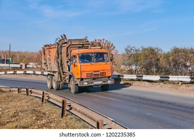 Krasnoyarsk, Russia - October 13, 2018: KamAZ garbage truck 65115 moves on an outcome on Northern the Highway. Front right view.