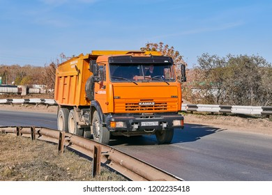Krasnoyarsk, Russia - October 13, 2018: KamAZ dump truck moves on an outcome on Northern the Highway. Front right view.