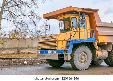 Krasnoyarsk, Russia - October 18, 2018: BelAZ dump truck, fragment, forward part of the car. Left front view.