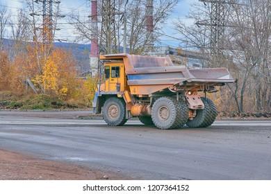 Krasnoyarsk, Russia - October 18, 2018: BelAZ dump truck goes for loading. Left rear view.
