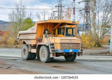 Krasnoyarsk, Russia - October 18, 2018: BelAZ the dump truck goes with freight, to the place of unloading. Right front view.