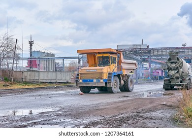 Krasnoyarsk, Russia - October 18, 2018: BelAZ dump truck goes for loading. Left front view.