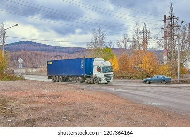 Krasnoyarsk, Russia - October 18, 2018: DAF CF truck transports a container to the river port. Right front view.