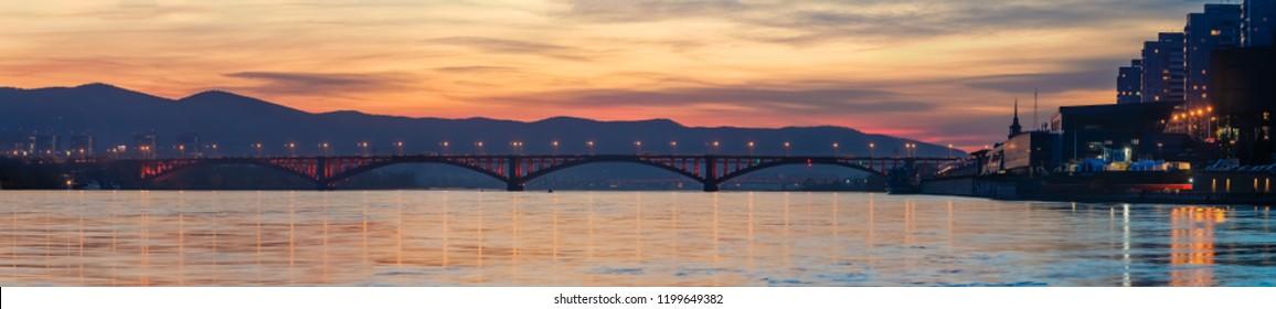 Krasnoyarsk, Russia -  October 4, 2018: Look  on the bridge through the Yenisei River in Siberia, Russia, shooting at night, noise, soft focus
