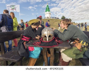 """Krasnoyarsk, Russia - September 03 2016: boys in suits sitting at a table of the Cossacks in the food festival """"Summer Kitchen"""" on the mountain Pokrovskaya"""