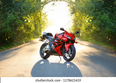 KRASNOYARSK, RUSSIA - September 7, 2018: Red and black sportbike Honda CBR 600 RR 2005 PC37 on sunset