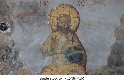 KRASNOYE SUMAROKOVO, KOSTROMA OBLAST / RUSSIA - JULY 29 2018: Ancient, XVIII century frescoes  on the walls of the ruined church of the Holy Trinity. Biblical stories. Jesus Christ