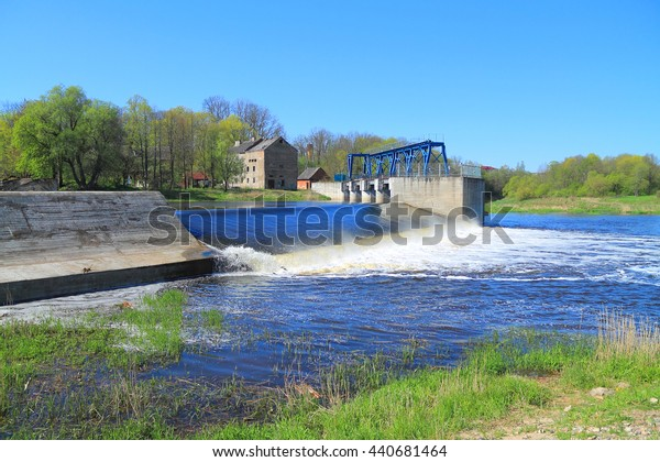 KRASNOZNAMENSK, KALININGRAD REGION, RUSSIA - MAY 5, 2016: Dam on the river to Sheshupa in the city of Krasnoznamensk in the Kaliningrad region