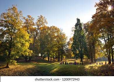 KRASNY DVUR, CZECH REPUBLIC - OCTOBER 11, 2018: Teachers and children from nursery school walking through the chateau park in sunny weather.