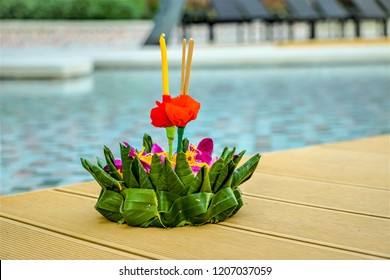 A krathong made from banana leaf and some flowers, candle and incense are needed, laying  near the swimming pool ,ready to float into the river in the evening as Thai national culture (Loy Krathong)