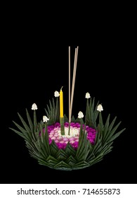 """""""Krathong"""" made from banana leaves and decorated with flowers, handmade for the Loy Krathong Festival in Sukhothai, Thailand. Isolated on black background"""