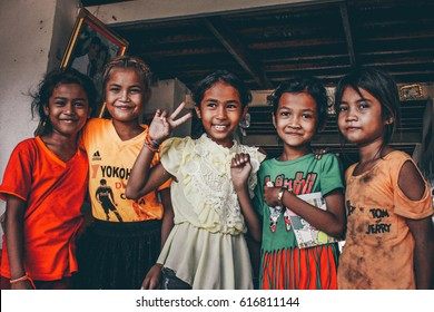 KRATIE, CAMBODIA – APRIL 20 2016: Unidentified girls posing for a picture in a poor village around Kratie.
