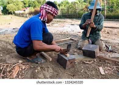 Kratie, Cambodia - December 7, 2018: Local village chief making a dirt compactor