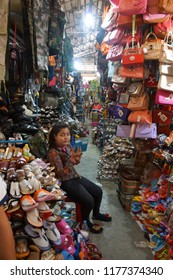 KRATIE, CAMBODIA - FEB 10, 2015 - Vendors sell clothing from their stall in the central market of  Kratie, Cambodia
