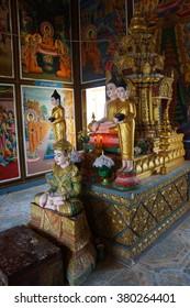 KRATIE, CAMBODIA - FEB 10, 2015 - Altar with golden  Buddha statues in  Sambuk Mountain Monastery, Kratie,  Cambodia