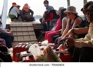KRATIE, CAMBODIA - FEB 9, 2015 -Passengers on small ferry on Mekong River, Kratie Province, Cambodia