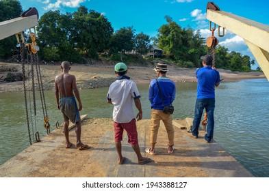 Kratie, Cambodia - October 1, 2017: People standing on boat crossing Mekong river