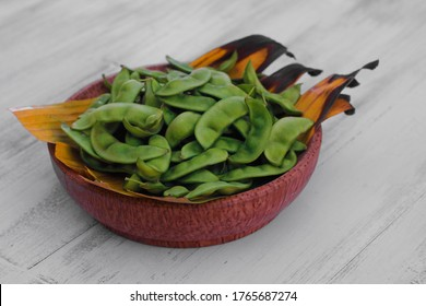 kratok beans (Phaseolus lunatus) on a wooden plate. Kratok, Javanese or Kekara beans are a type of beans from the Fabaceae tribe.