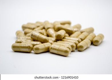 Kratom capsules isolated on white background with narrow field of focus