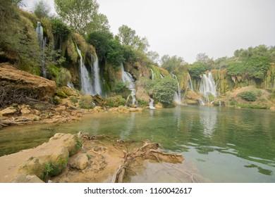Kravica waterfall, often erroneously called Kravice, is a large tufa cascade on the Trebižat River, in the karstic heartland of Herzegovina in Bosnia and Herzegovina