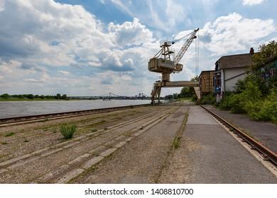 Krefeld - View to former Harbour Crane with River Rhine Bridge in the background,  North Rhine Westphalia, Germany, 24.05.2019