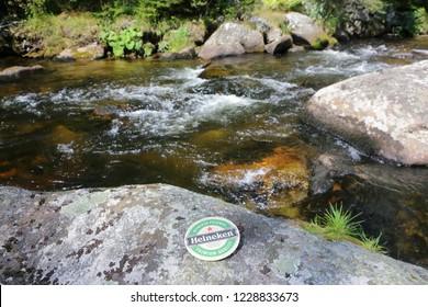 Kremelna river, Prasily, Czech - 8 July 2018.: Beer mat HEINEKEN beer. Beer mats from Heineken Lager Beer, it was first brewed by Gerard Adriaan Heineken in 1873