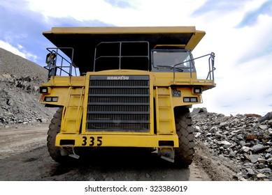 Kremenchug, Ukraine - 26 June 2010. Yellow dump truck Komatsu, driving on a road in a stone quarry